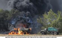 140907-ucrania-vehiculos-militares-tras-enfrentamiento-en-berezove