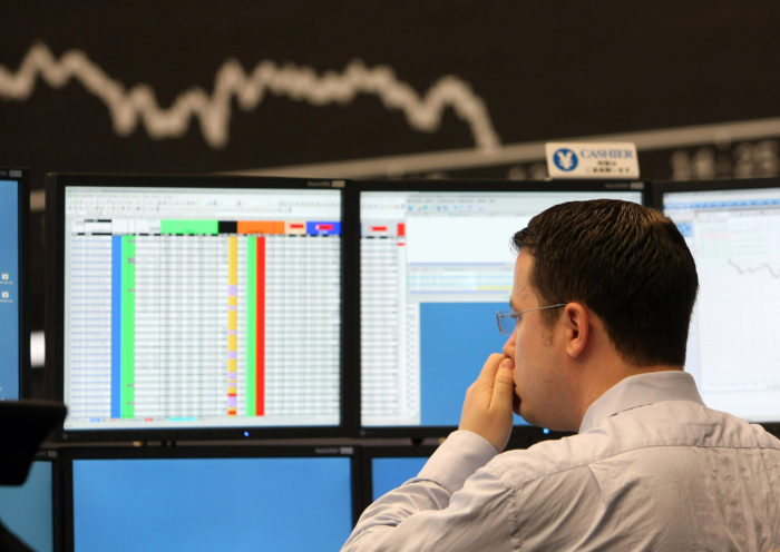 FRANKFURT AM MAIN, GERMANY - SEPTEMBER 15:  A trader rubs his nose during a trading session on the trading floor at Frankfurt stock exchange on September 15, 2008 in Frankfurt, Germany. Due to collapse of U.S. fourth largest investment bank Lehman Brothers Holdings Inc. the German DAX Index fell to the lowest since October 2006.  (Photo by Ralph Orlowski/Getty Images)